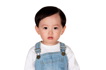 East Asian male studio portrait of a young child Stock Photo