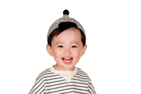 East Asian male with happy appearance Studio portrait of young child