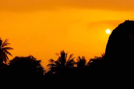 Beautiful orange sunset over the mountain in Thailand photo