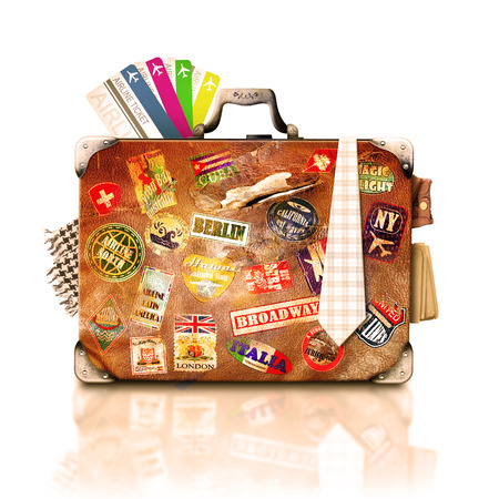 The old suitcase for travel and tourism with things, tickets and travel stickers Stock Photo