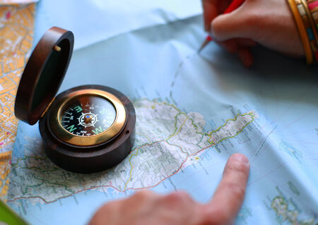 map pencil: Route on the map with the help of a compass, travel Stock Photo