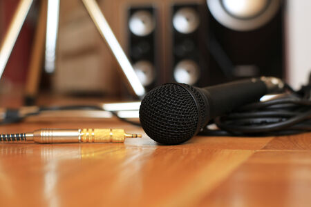 sound system: Music microphone wire on the background of the audio system Stock Photo