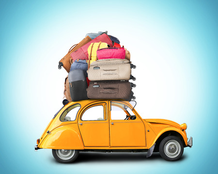 Retro car with Luggage on the roof, tourism
