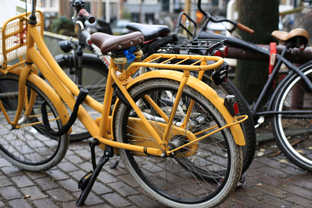 Bicycles parked near the waterfront in Amsterdam photo