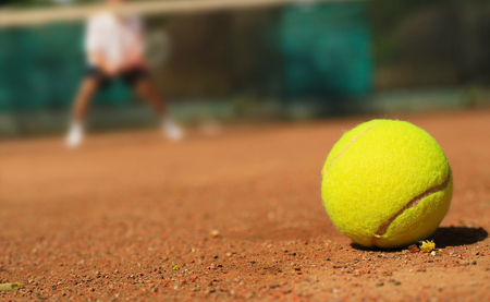 Tennis tennis ball on the ground and the player Stok Fotoğraf