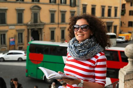 tourist guide: Tourist in Rome in Italy looks at the guide