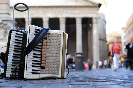 Accordion and harmonica in the background of Pantheon in Rome