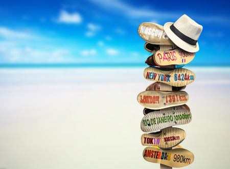 culture: Signpost made of Shoe soles with cities Stock Photo
