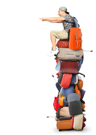 travel bag: Tourist sits on a pile of bags and backpacks