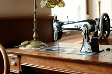sewing machine: Black retro sewing machine in an old house