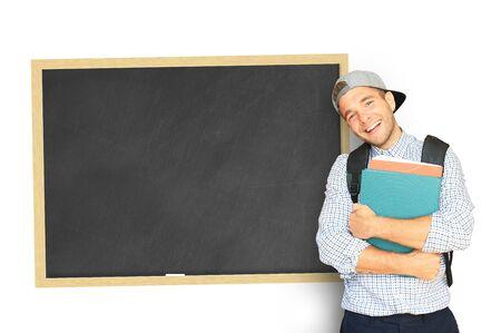 teorema: Estudiante con una mochila cerca de los consejos escolares Foto de archivo