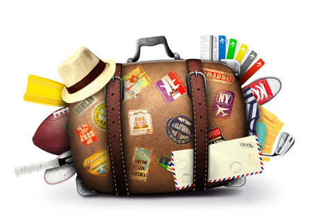 Full suitcase of a traveler with travel stickers