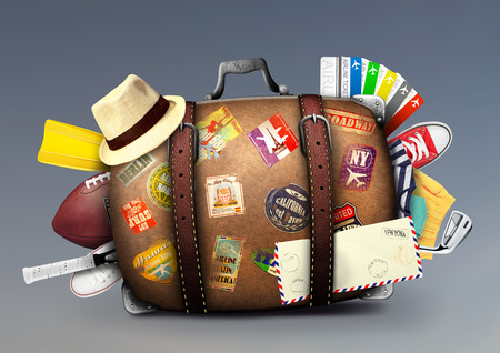 travel luggage: Full suitcase of a traveler with travel stickers