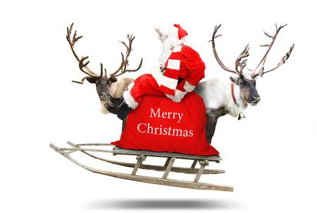 Santa Claus flies in a sleigh with reindeer