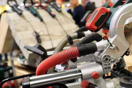 hardware tools: Circular saw with a wooden beam and measuring scale Stock Photo