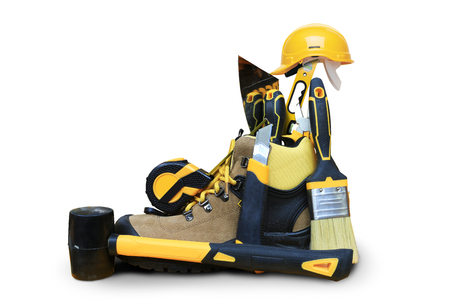 putty knives: Shoe construction with tools and construction helmet Stock Photo