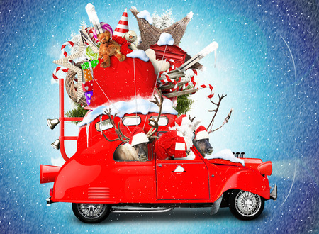 Santa Claus with reindeer in a car with gifts 스톡 콘텐츠