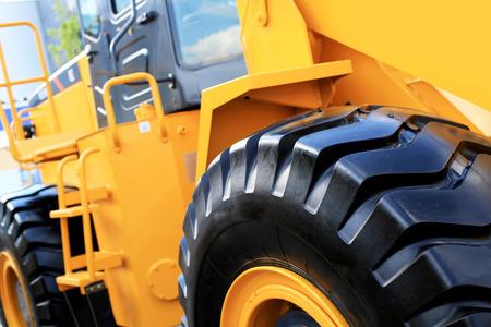 big wheel: Large yellow bulldozer with a big wheel