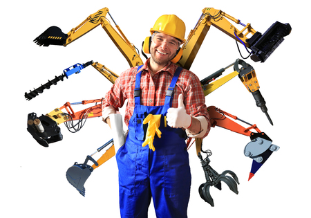 Construction worker in yellow helmet and parts of construction machinery Stok Fotoğraf - 50406308