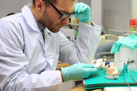 Dental technician denture with gypsum in the laboratory