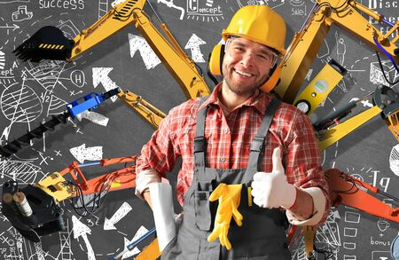 putty knives: Builder in yellow helmet, protective glasses and working clothes