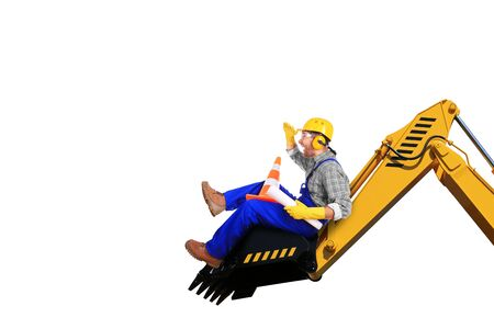 yellow helmet: Builder in yellow helmet on the excavator Stock Photo