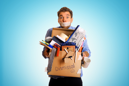 Dismissed worker with a box of his things Stock Photo