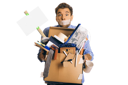 business problems: Dismissed worker with a box of his things Stock Photo