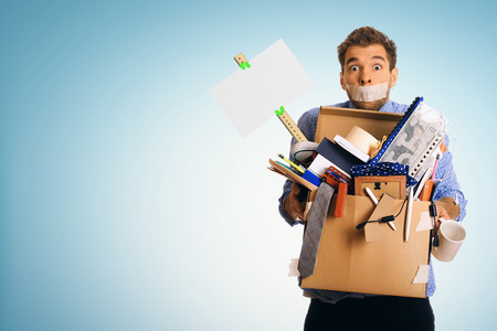 unemployed dismissed: Dismissed worker with a box of his things Stock Photo