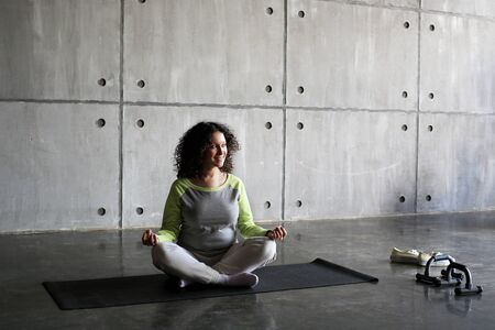 fitness motivation: Woman on the Mat practicing yoga and fitness