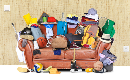 Large leather sofa with a bunch of different things Stok Fotoğraf