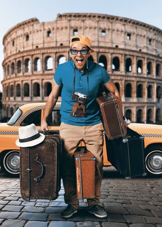 travel bag: Tourist on vacation with a bunch of old suitcases