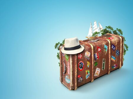 abroad: Leather suitcase of a traveler with travel stickers Stock Photo