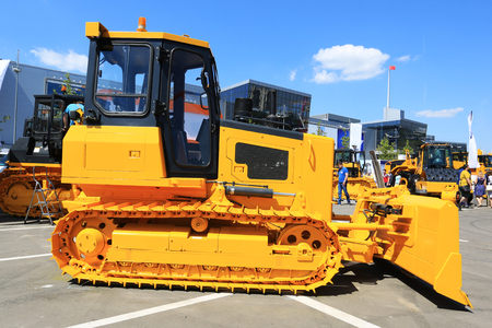 machinery machine: Yellow new tractor, industry engineering and construction Stock Photo