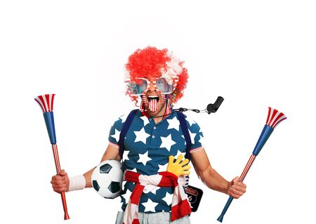 USA football fan in a red wig and horns