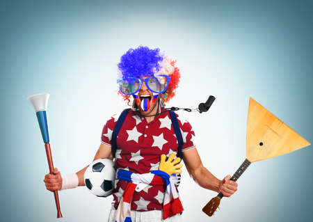 Russia football fan in a red wig and horns Stock Photo