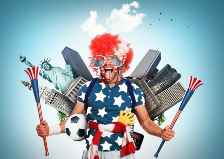 vuvuzela: USA football fan in a red wig and horns