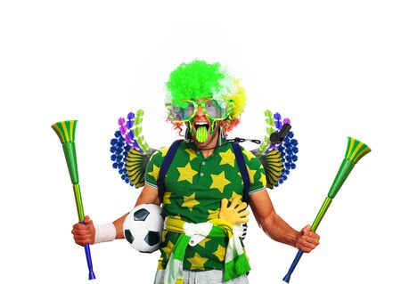 vuvuzela: Brazil football fan in a green wig and horns