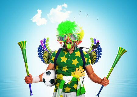 Brazil football fan in a green wig and horns