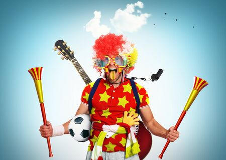 vuvuzela: Spain football fan in a red wig and horns Stock Photo