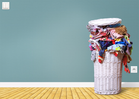 lot of: White straw basket full of dirty Laundry