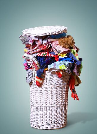 stain: White straw basket full of dirty Laundry