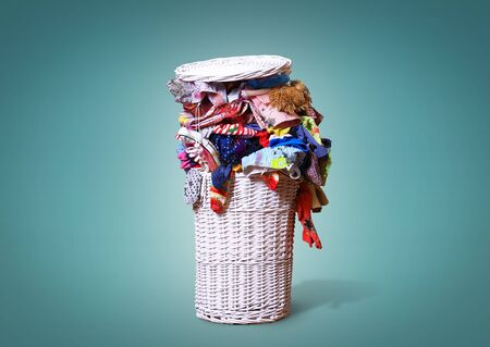 White straw basket full of dirty Laundry Stock Photo - 60673593
