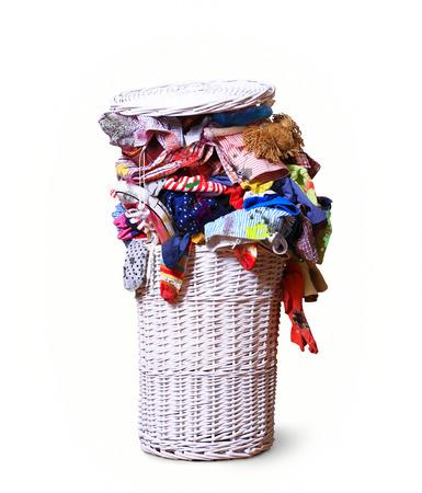 White straw basket full of dirty Laundry