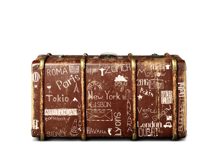 Retro suitcase of a traveler with travel marks
