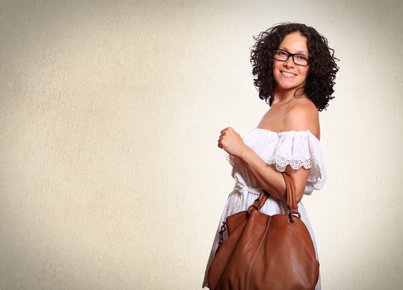 woman  glasses: Young lady in white dress and with handbag