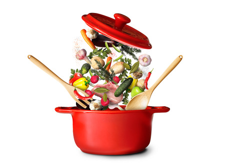 Big red pot for soup with vegetables Фото со стока - 65840833