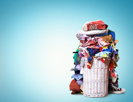 White straw basket full of dirty Laundry Stock Photo - 65746223