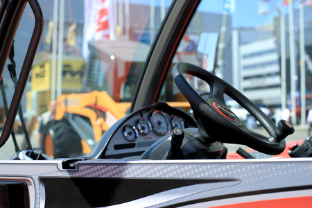 crane bucket: Work place in forklift with dashboard and wheel