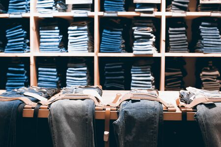 tienda de ropa: Denim clothes are laid out in a clothing store Foto de archivo